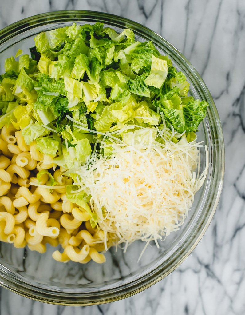ingredients for Caesar pasta salad in a bowl