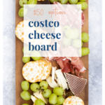 $50 Costco charcuterie board with cheese, meat, crackers, and grapes