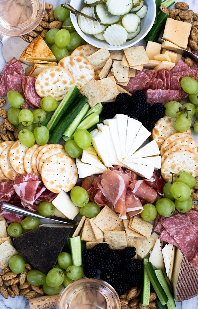 Costco meat and cheese platter with crackers and grapes