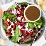 bowl of blue cheese steak salad and dressing