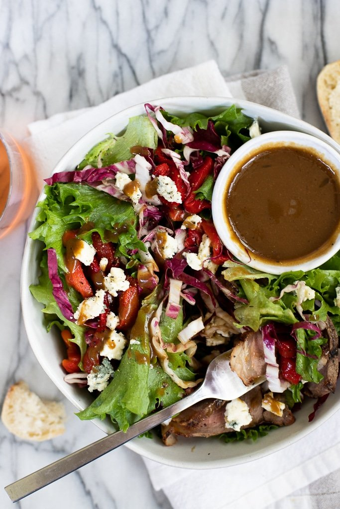 grilled steak salad with dressing mixed in