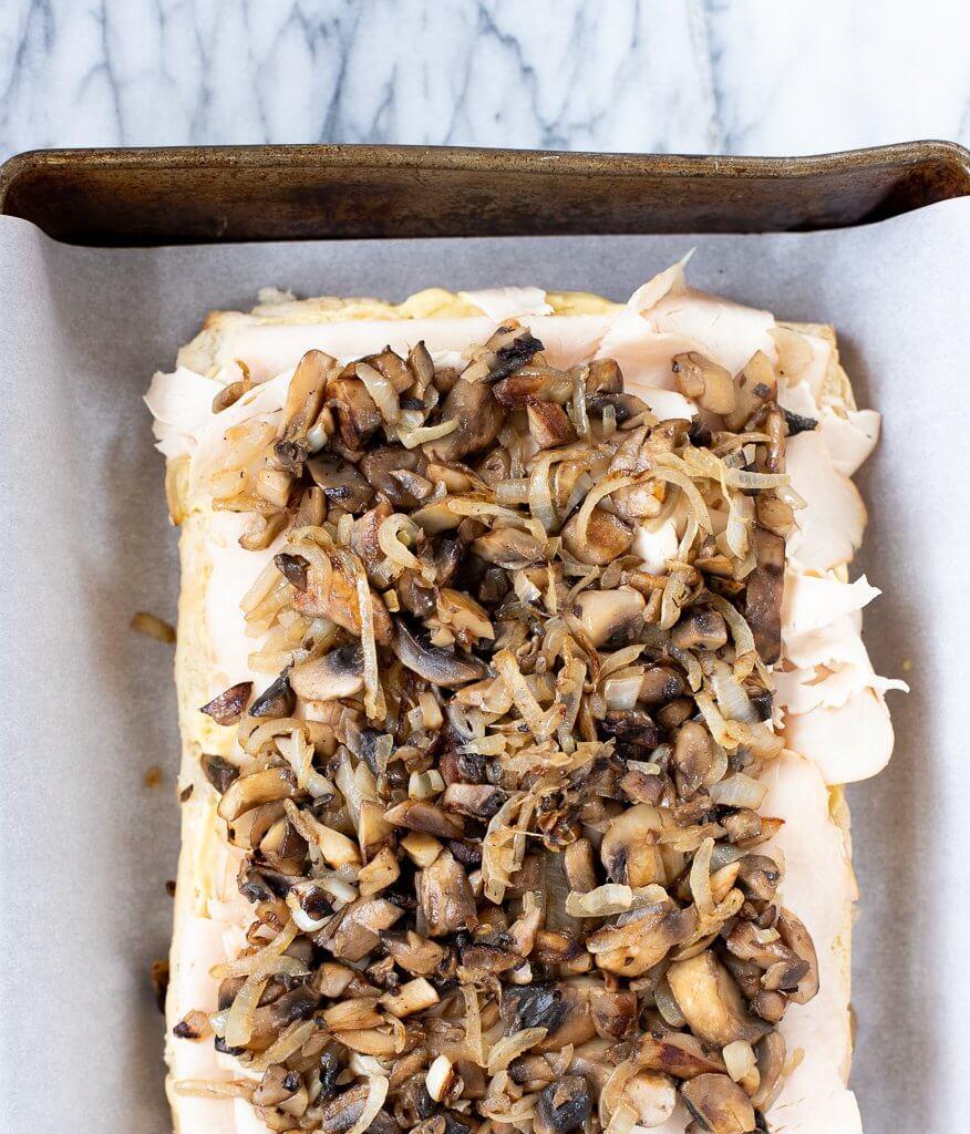 Hawaiian baked turkey sliders with mushroom and onion layer