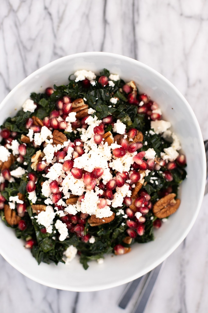 White bowl with kale pomegranate salad for Christmas