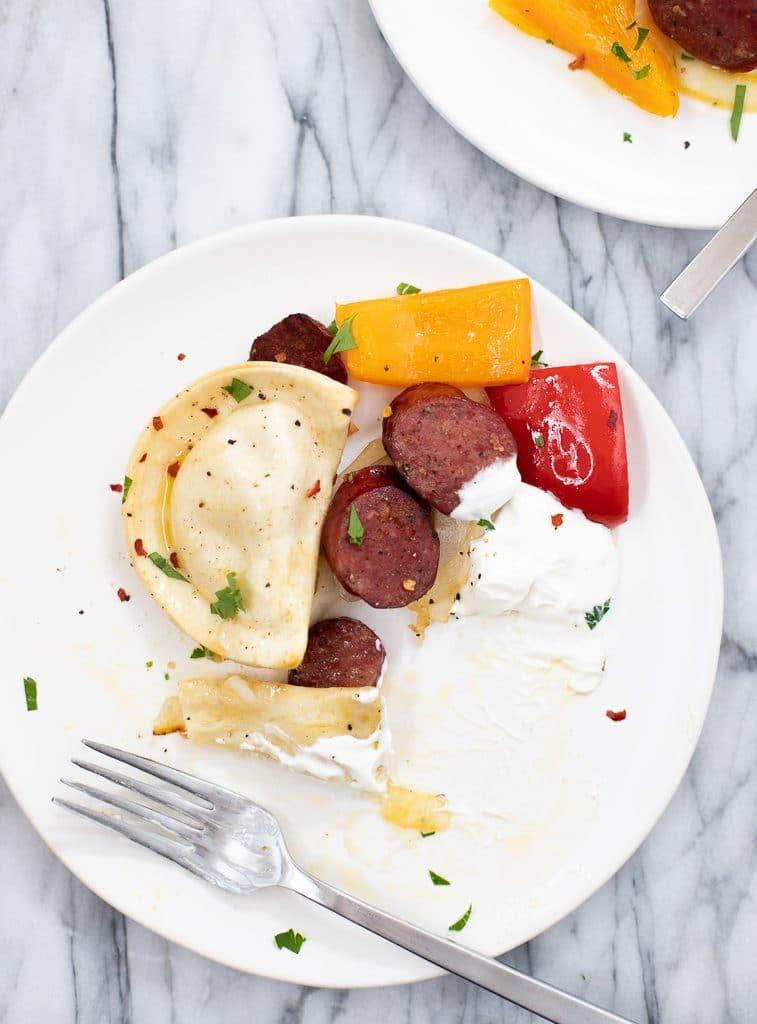 pierogies and kielbasa sheet pan dinner on a plate