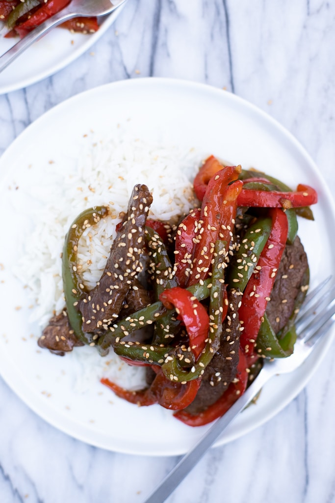 Pepper steak stir fry on a plate with rice