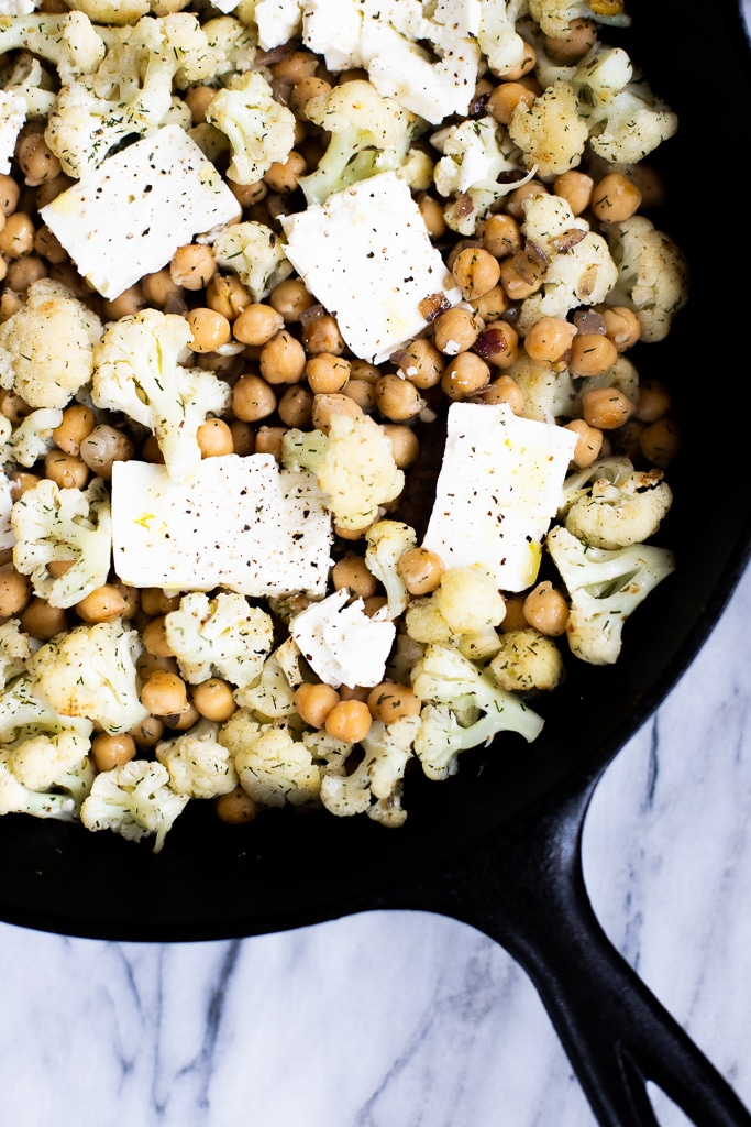 chickpeas and cauliflower in a skillet