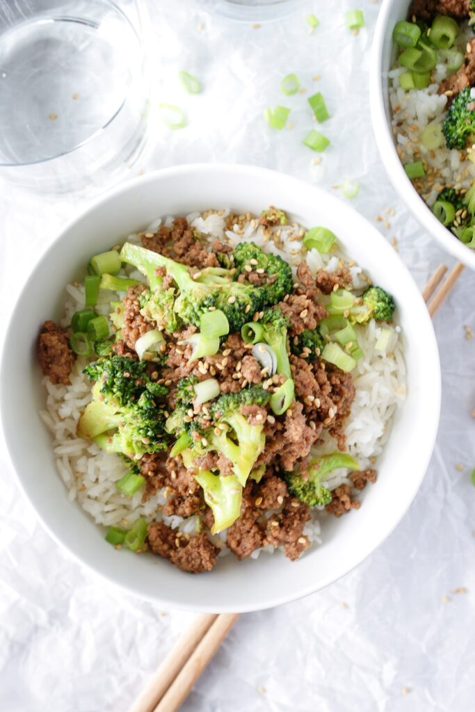 beef and broccoli stir fry in white bowl