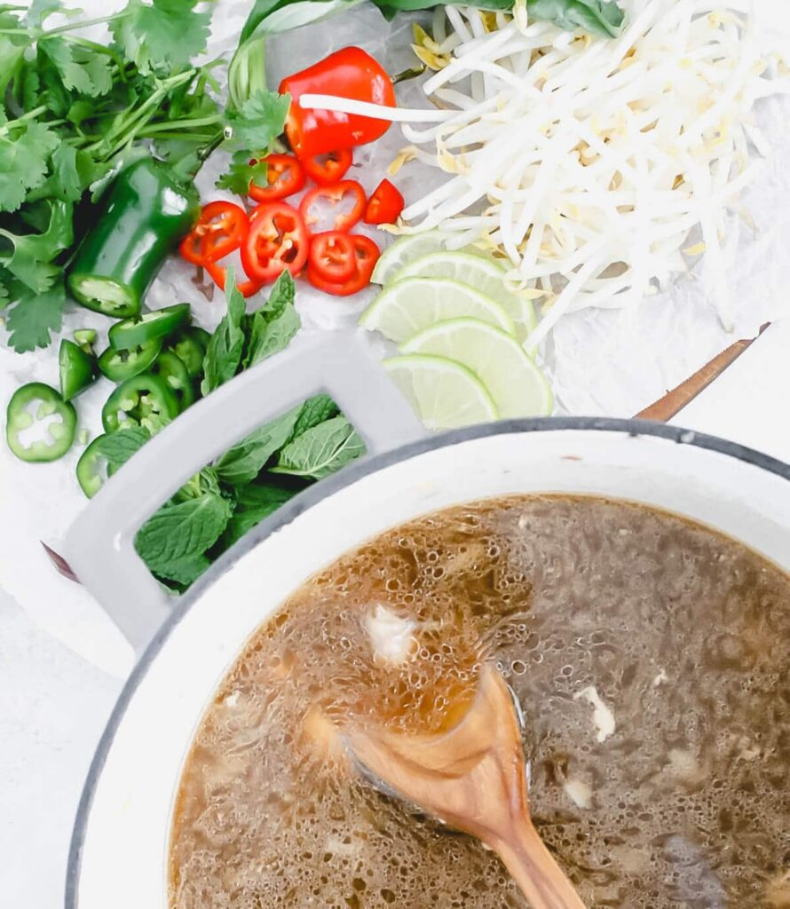 chicken pho pot of soup and toppings