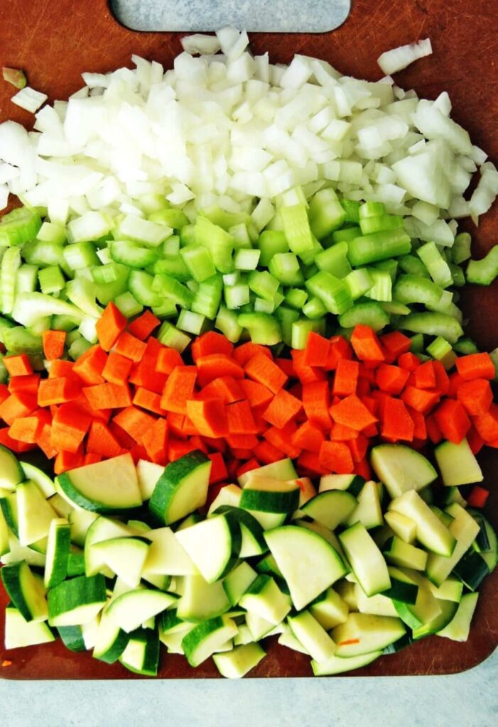 Vegetables for healthy minestrone soup on a cutting board