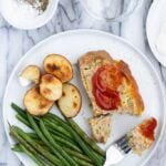 Plate with healthy turkey meatloaf with green beans and potatoes
