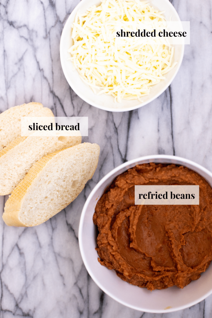 Ingredients for molletes: bread, refried beans and shredded cheese
