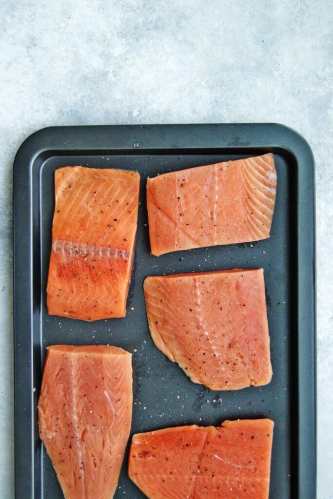 salmon filets on a pan