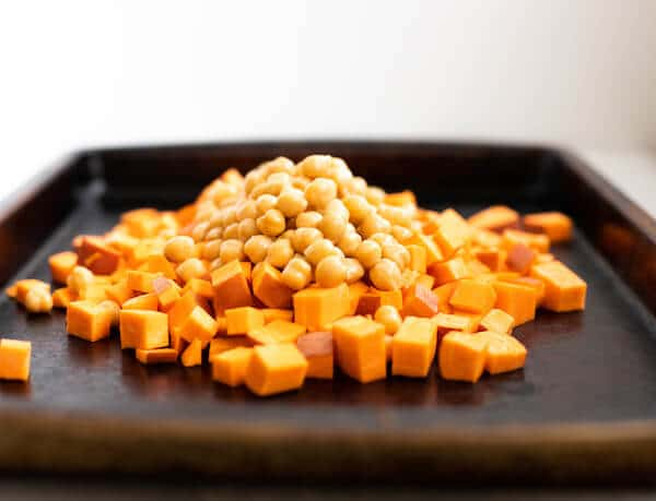 pan of garbanzo beans and sweet potato for roasting