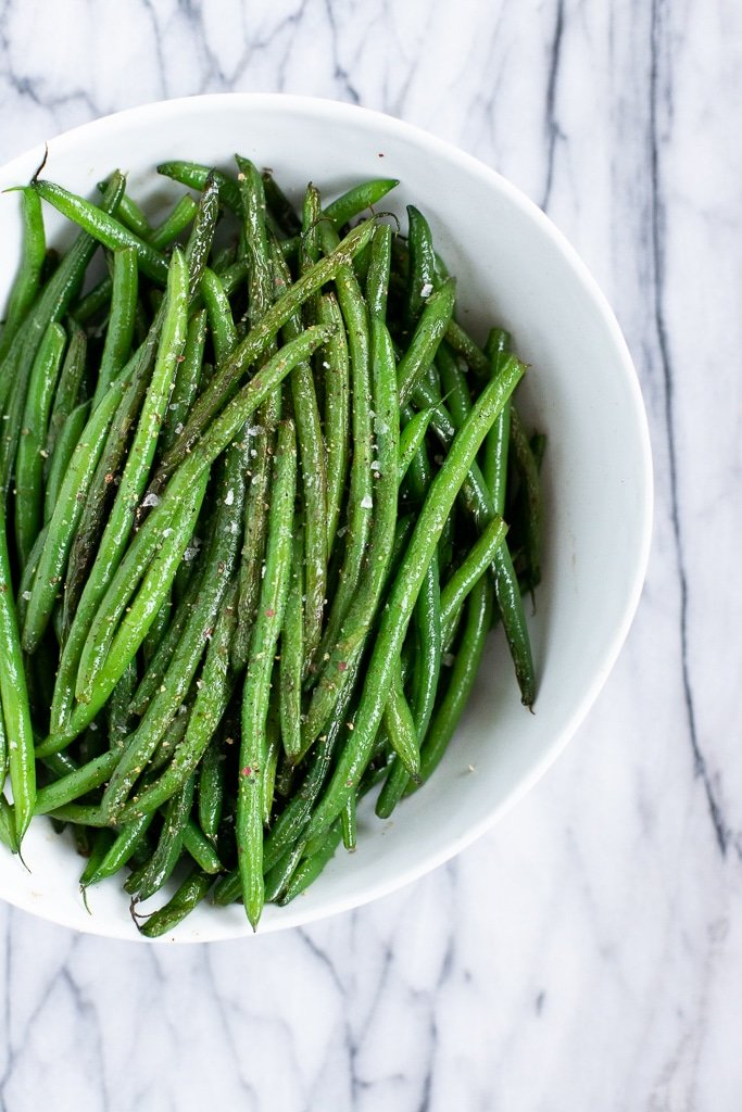 White bowl with sauteed haricots verts